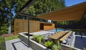 Wooden pool house design perceived as a pavilion.
