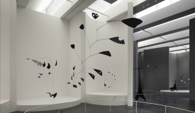 Frank Gehry creates curves and boxy podiums as the setting for Alexander Calder's works at LACMA
